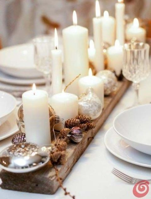place a wooden plank on the table, cover it with pinecones and candles