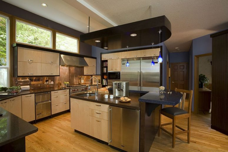 stainless steel kitchen with a polished copper backsplash