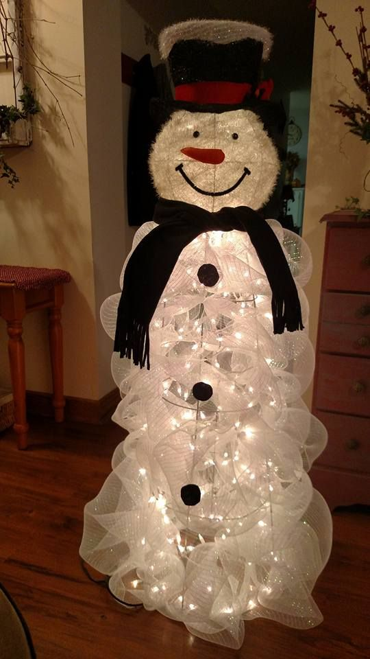 a tomato cage lit up snowman can be DIYed of lights and white mesh ribbon
