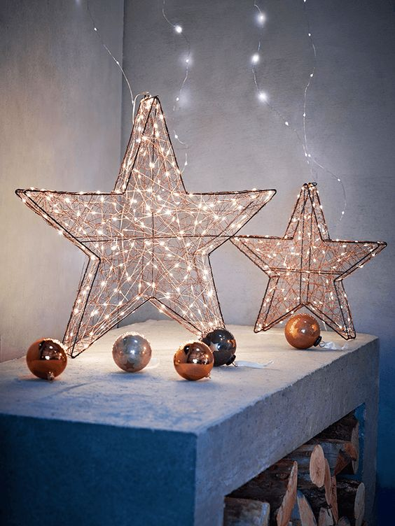 copper lit up stars and ornaments for decor