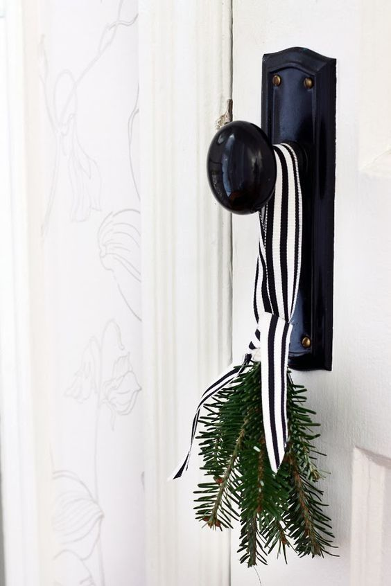 evergreen with black and white striped ribbon