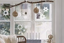 25 hang a branch and ornaments of various kinds on it, and add paper snowflakes