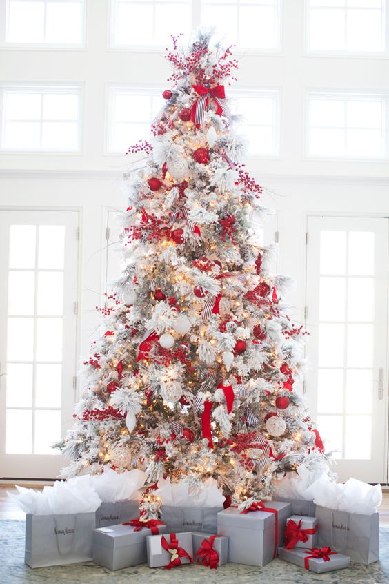 26 best flocked christmas tree d cor ideas digsdigs for Christmas tree with red and silver decorations