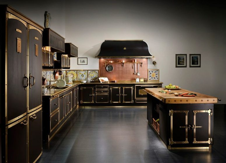 stunning black art deco kitchen with a copper backsplash is bursting with style