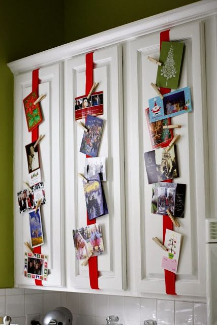 attach red ribbon to the cabinets and then cards on it