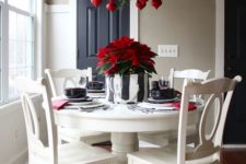 26 fern branches and seeral bold red ornaments echo with a green and red centerpiece