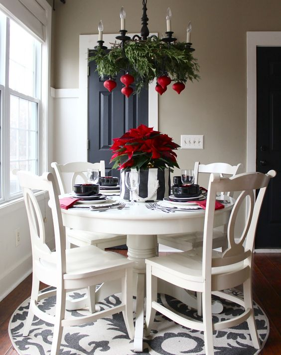 fern branches and seeral bold red ornaments echo with a green and red centerpiece