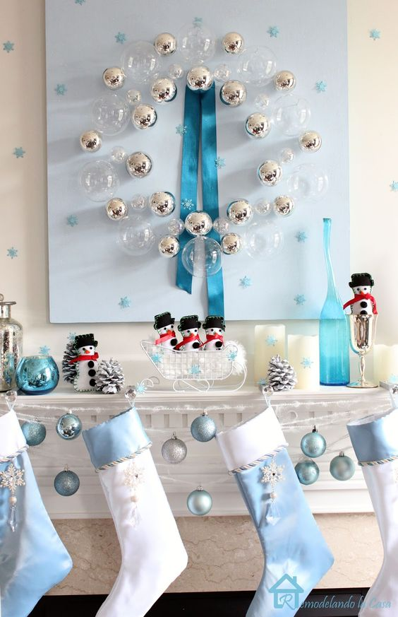 serenity blue and white ornaments and stockings for mantel decor