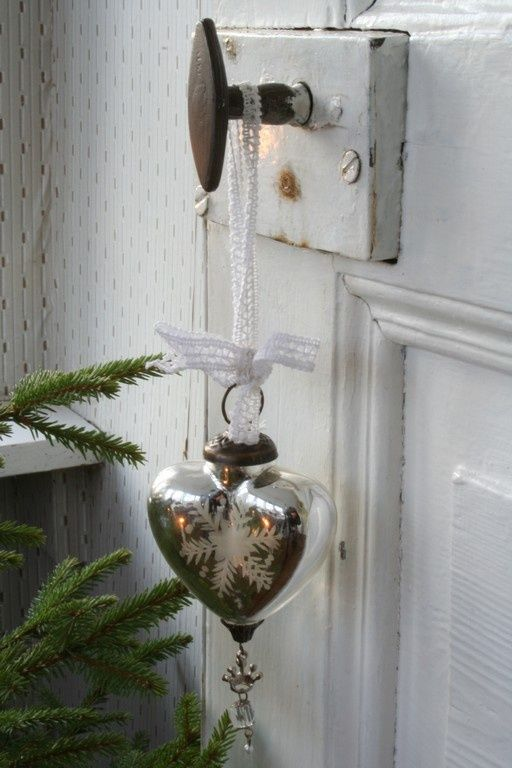 shabby chic heart-shaped ornament with a snowflake