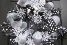27 a black and white deco mesh wreath with snowflakes