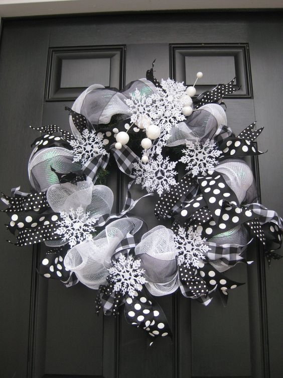 a black and white deco mesh wreath with snowflakes
