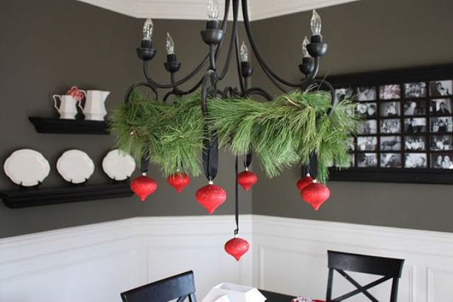 a black chandelier contrasts with red ornaments