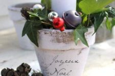 27 a planting pot with ornaments and a candle