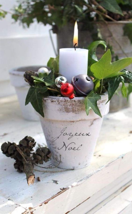 a planting pot with ornaments and a candle
