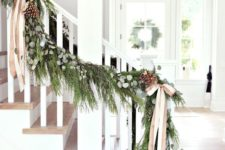 27 evergreen garland with pinecones and neutral bows