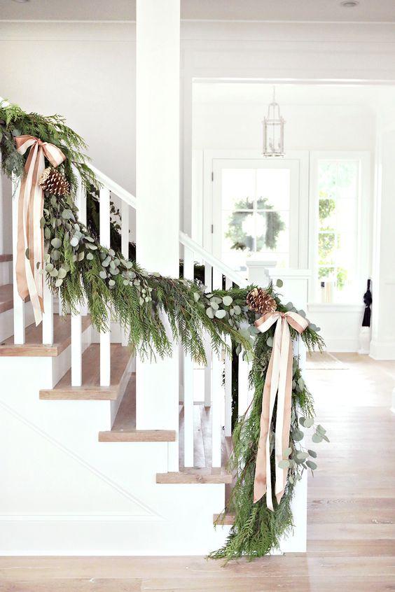 evergreen garland with pinecones and neutral bows