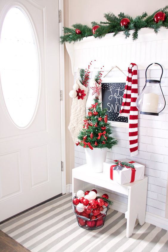 red and white ornaments in a wire bucket, red ornaments for a tiny tree and white stockings for the scene