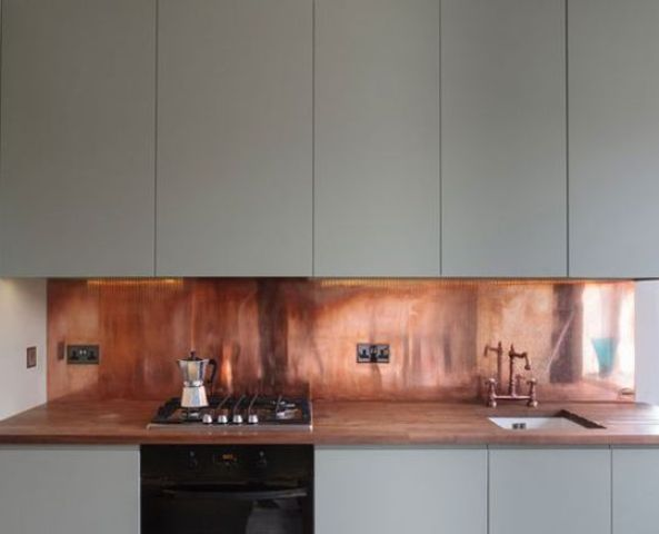 warm copper adds a sense of luxury to this kitchen