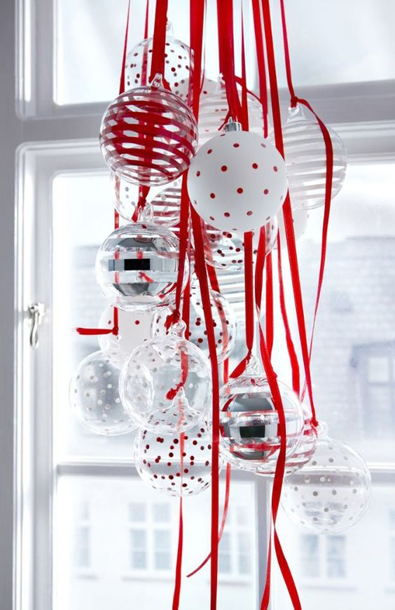 a cluster of red, white and silver ornaments will be great for window decor