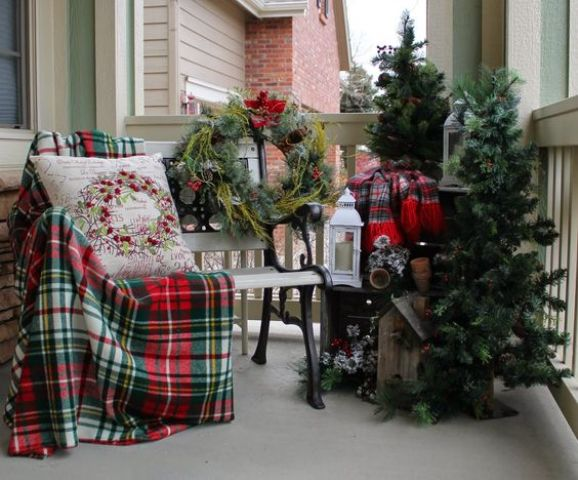 a couple of fir trees, a messy wreath and plaid fabric