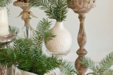 28 large pinecones, evergreens and candles are perfect for decorating a table