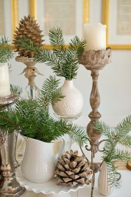 large pinecones, evergreens and candles are perfect for decorating a table
