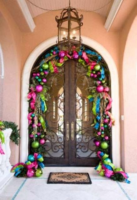 super bold Christmas ornament garland over the door