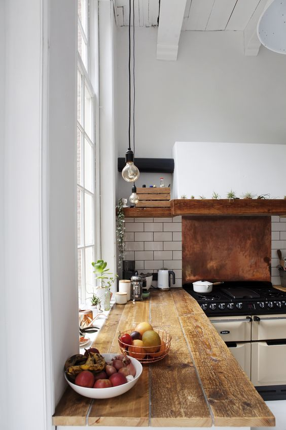 white subway tiles and a copper backsplash for the cooker