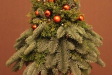 29 a simple small arrangement with a candles, evergreens and tiny copper ornaments