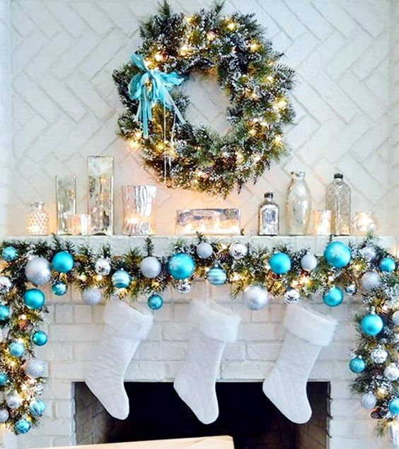 blue, silver and white Christmas garland and white stockings never looked cuter than that