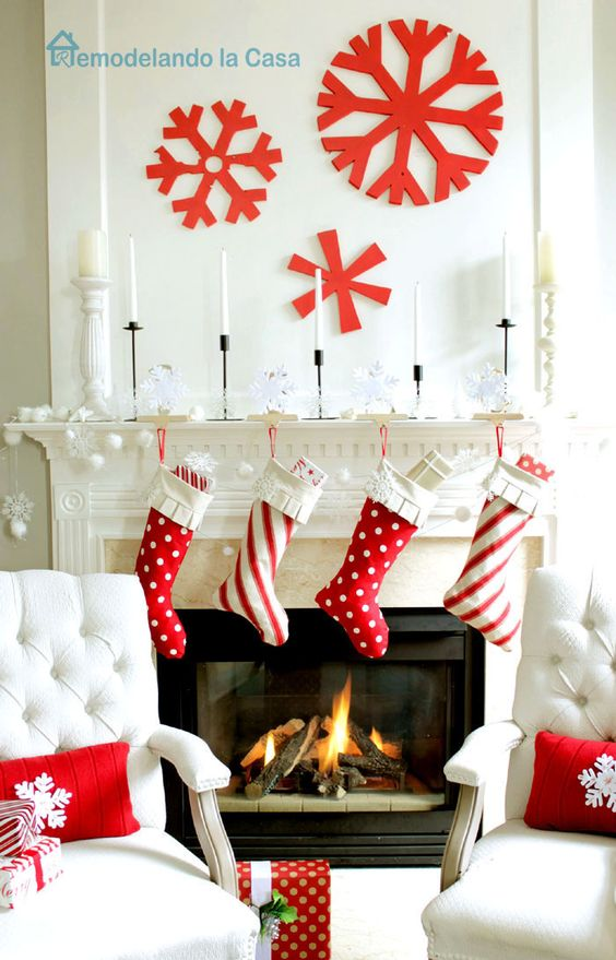 red and white stockings, large red snowflakes on the wall