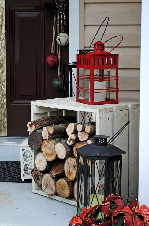 a firewood stand and a couple of lanterns