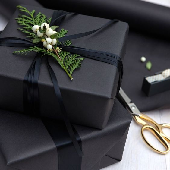 charcoal grey wrapping paper, black ribbon and fresh greenery