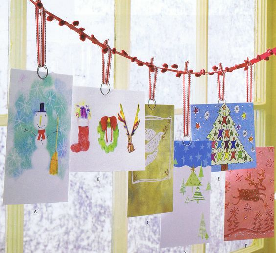 hang cards on a pompom thread next to the window