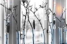 31 branches in tube vases and pinecones for rustic window decor