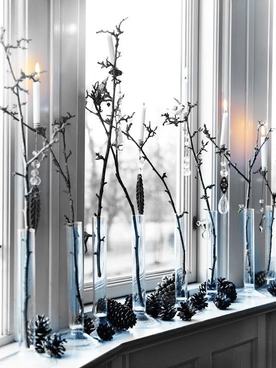 branches in tube vases and pinecones for rustic window decor