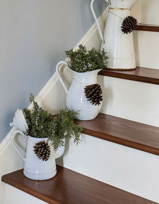 fresh juniper in vintage enamelware placed right on the stairs