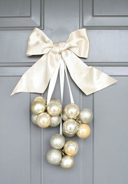 silver, pearl and gold ornaments and a large ribbon bow