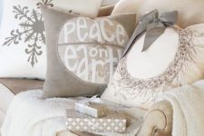 32 a neutral throw and neutral pillows with winter patterns