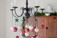 32 take champagne and red ornaments and hang them on green twine