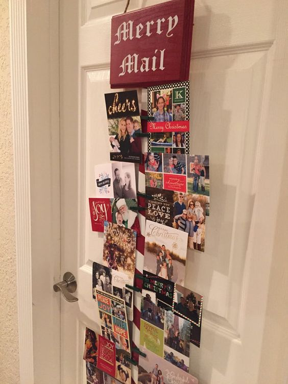 Christmas card holder display on the door
