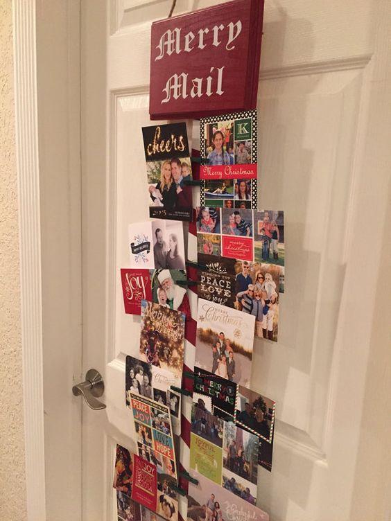 Christmas card holder display on the door