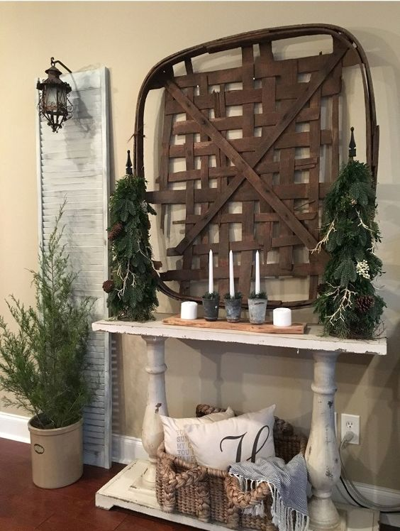 a tobacco basket, evergreens, candles and moss is right what you need for an organic winter entryway