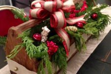 33 a vitnage toolbox may be used for arrangements, fill it with evergreens, ornaments and berries