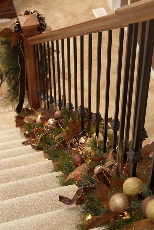 Brown, Green And Gold Garland Placed On The Staircase