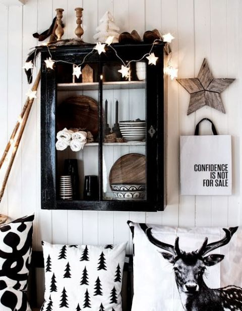 printed monochrome pillows, a white star garland