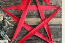 33 reclaimed wooden board decor with a red ribbon star