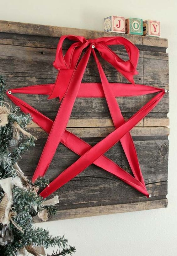 reclaimed wooden board decor with a red ribbon star