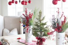 33 rock red ornaments and evergreen branches