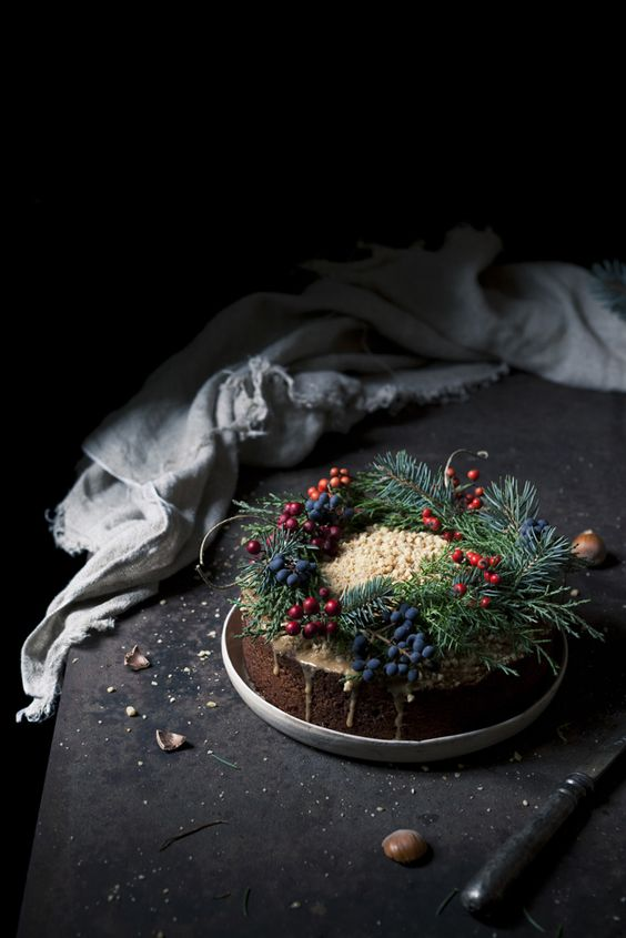traditional Christmas cake withevergreens and berries